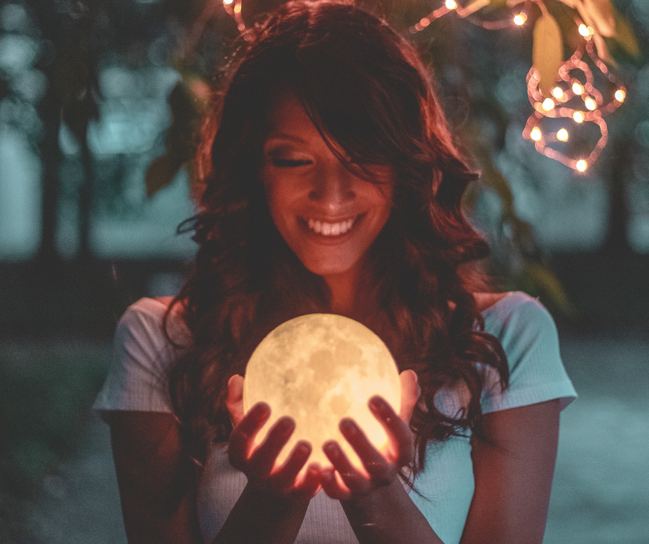 Smiling woman with a crystal ball.